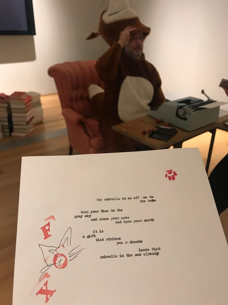 Poetry Fox types out a poem for a GRAM visitor.