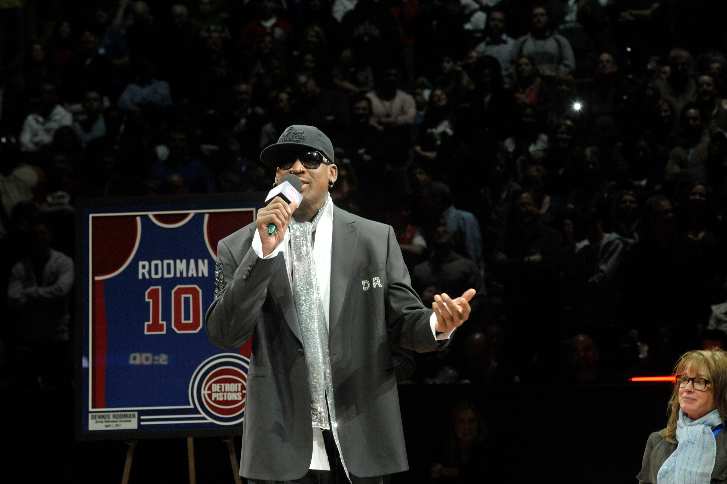 Dennis Rodman delivers game ball at Grand Rapids Drive game.
