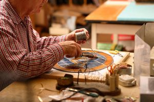 A Clark Retirement Community resident works on an art project.