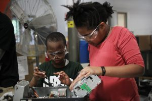 School age kids participate in educational programs about recycling at Comprenew.