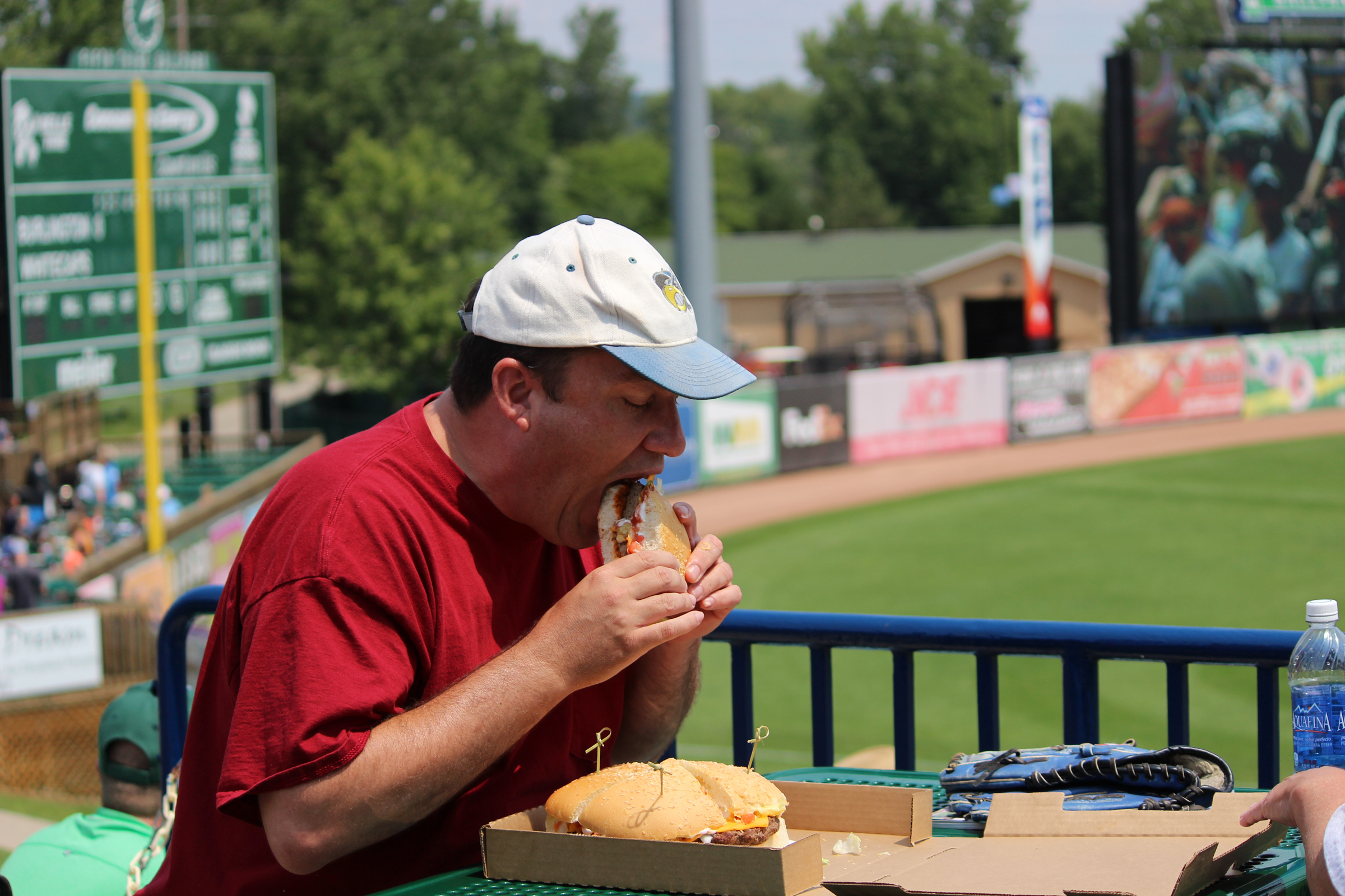 Fan takes on the Fifth Third Burger challenge.