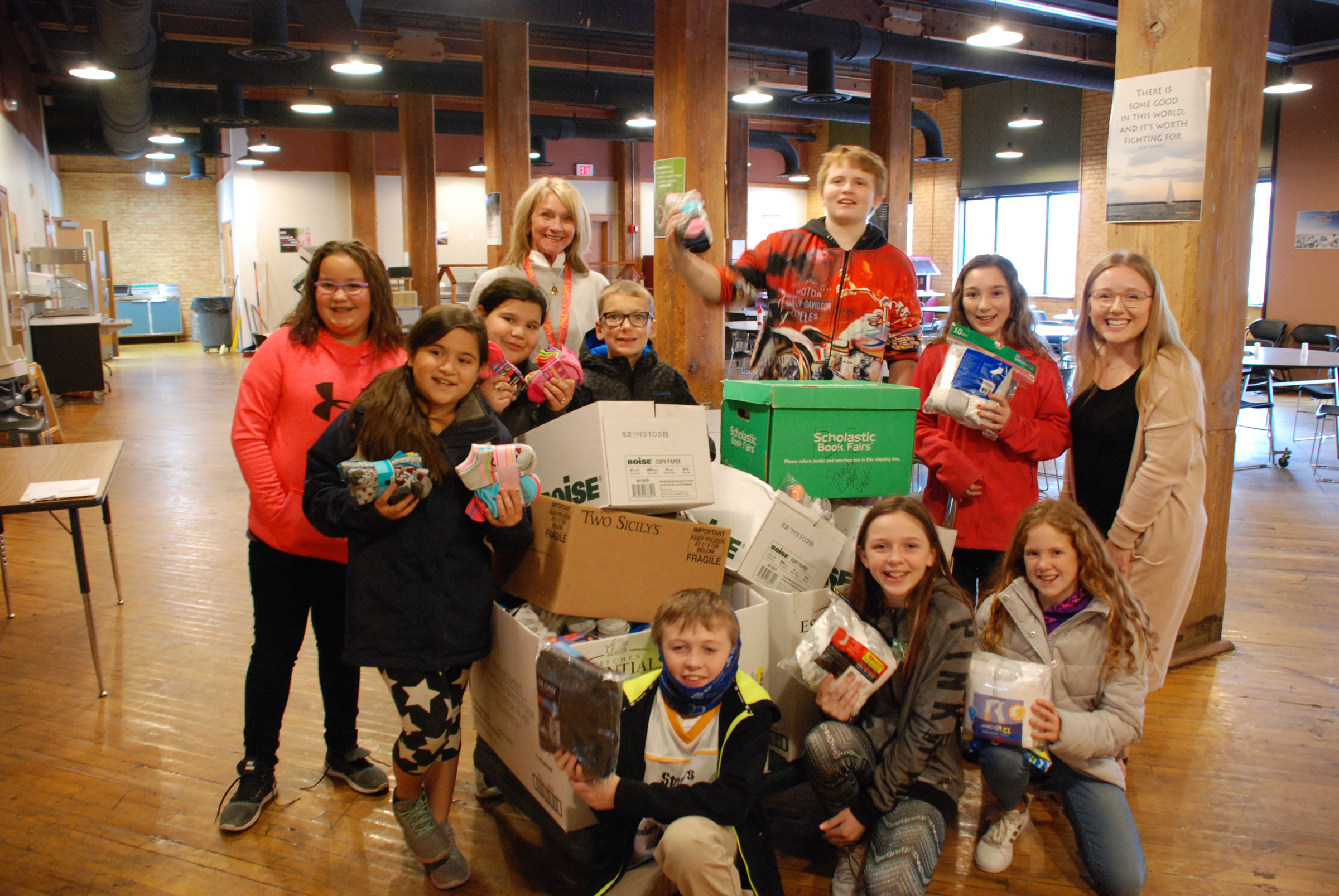 Kids pitch in to collect winter items for those in need at Mel Trotter.