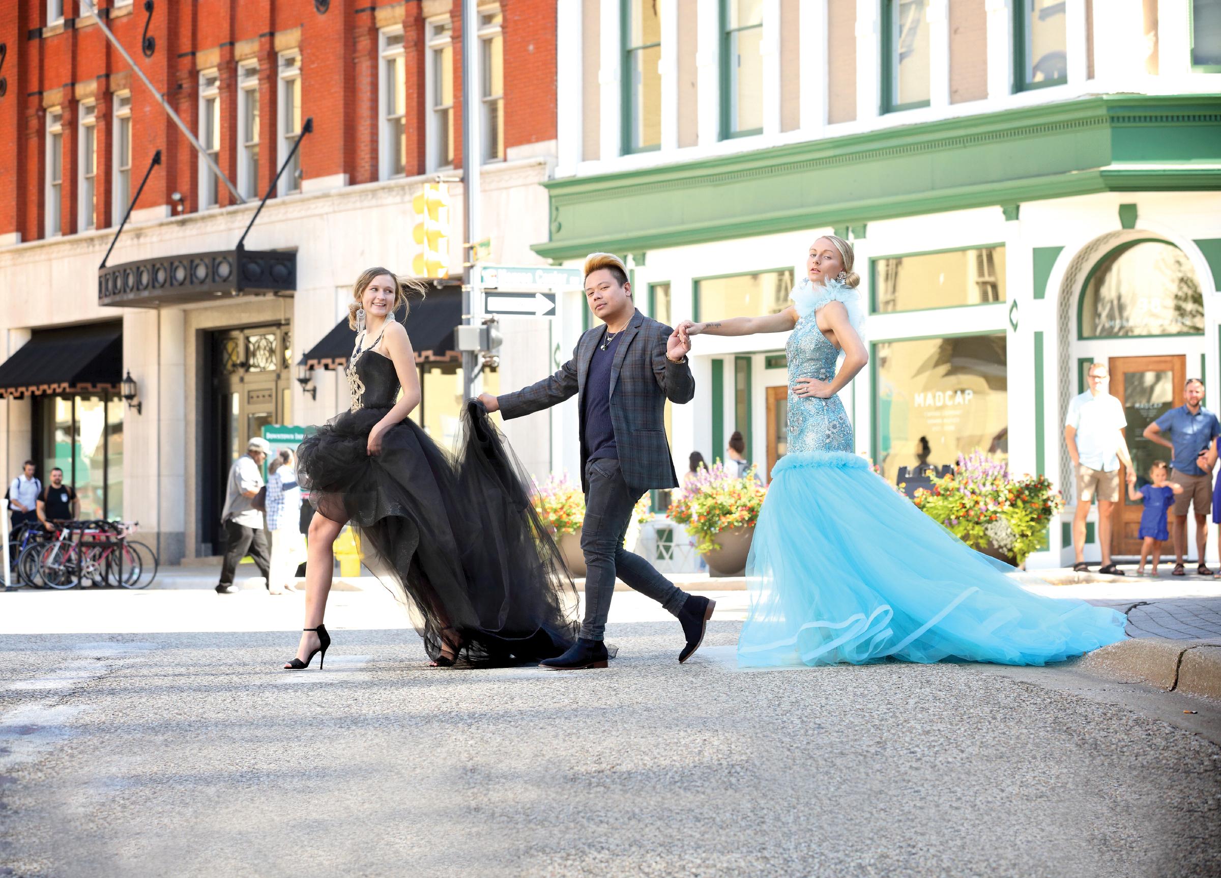 Models Mackenzie Santamour (Blue), Marissa Faust (Black) with designer Romel Caylan. Photo by Johnny Quirin.