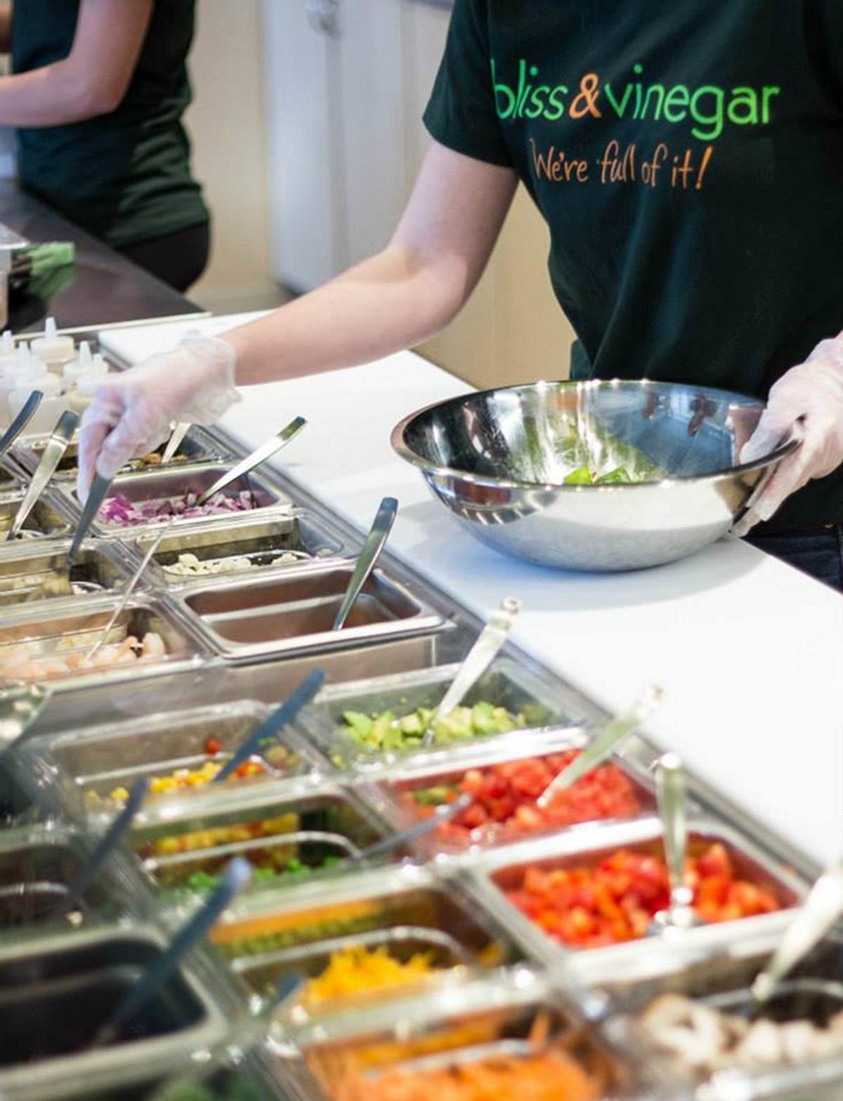 Bliss & Vinegar salad ingredients worker