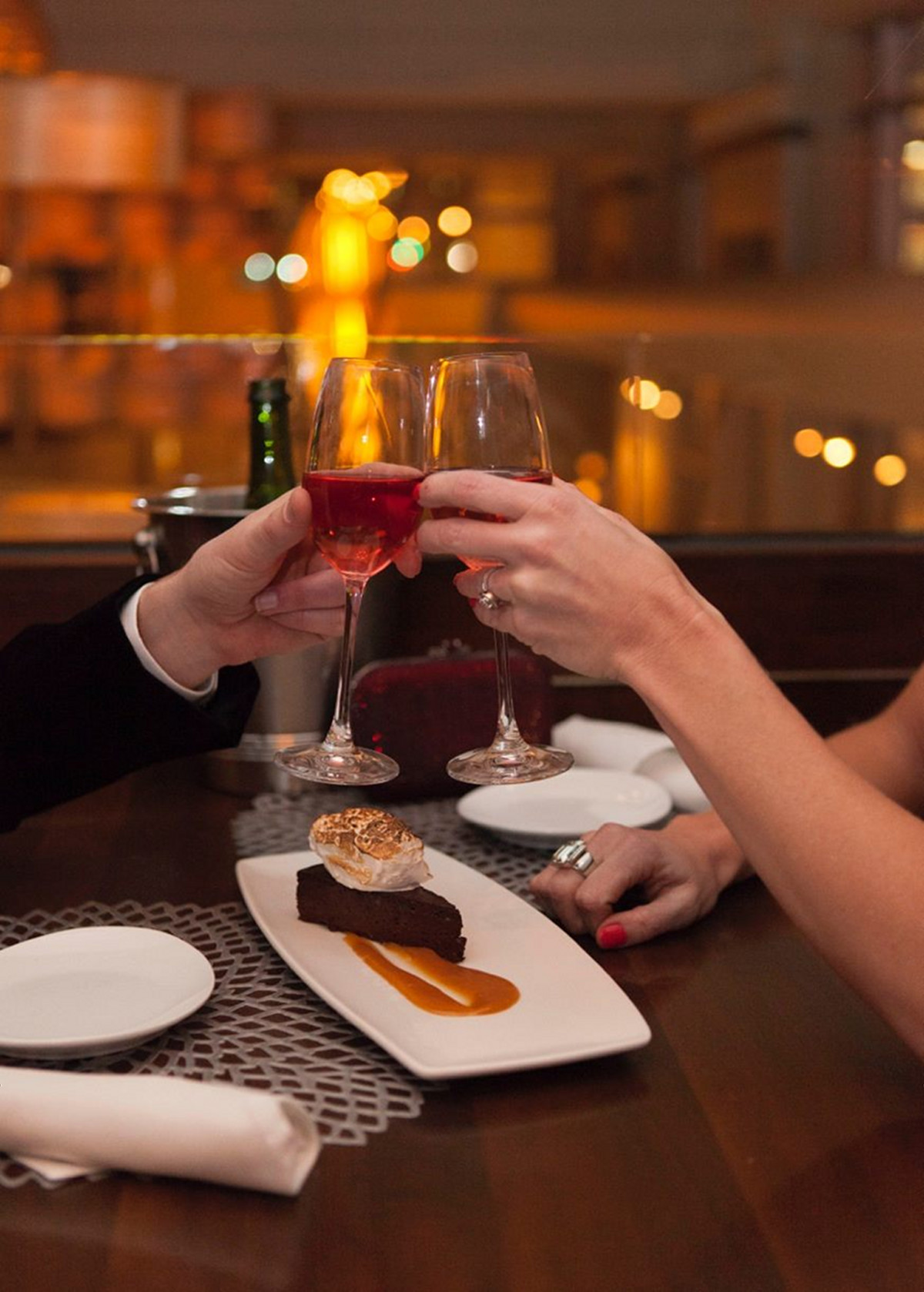 Reserve Wine & Food couple wine glasses cheers