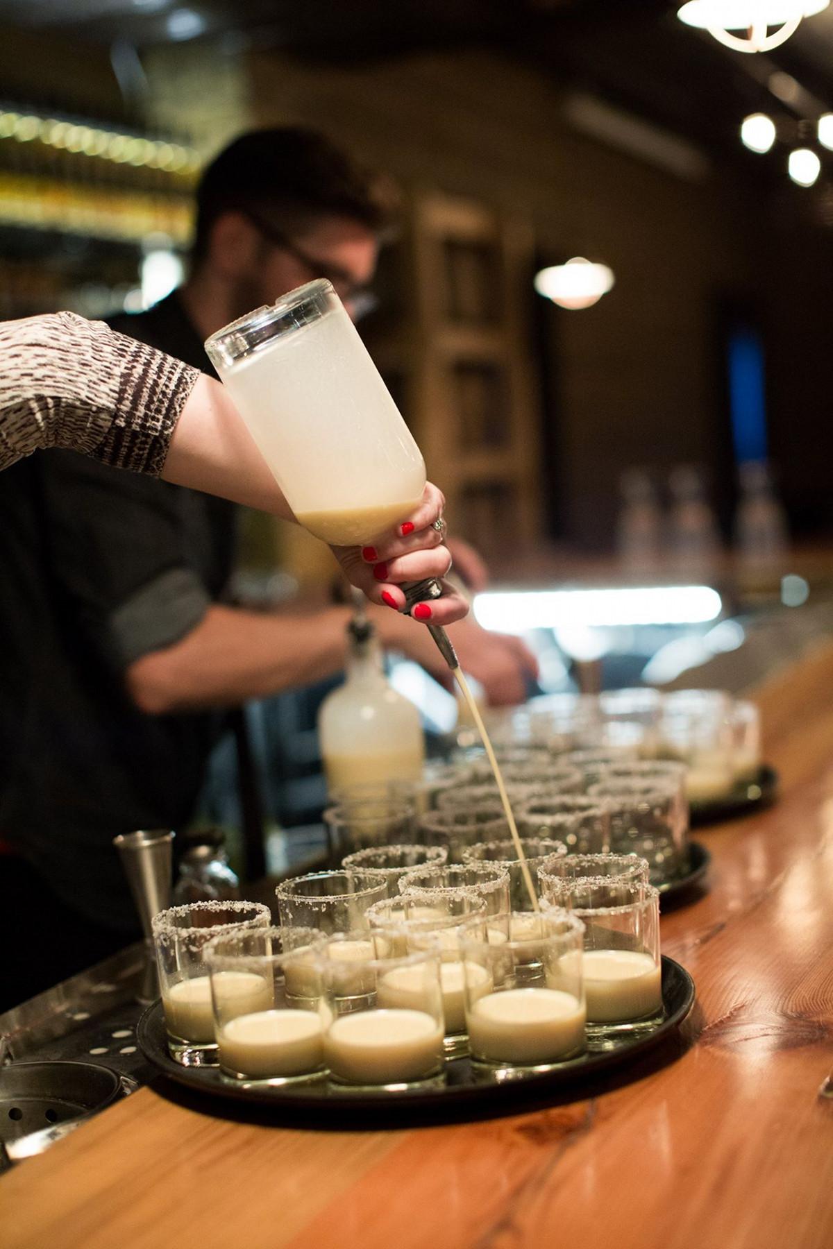 Long Road Distillers bartender bar gasses tray