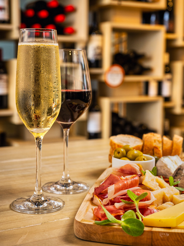 Aperitivo champagne and wine glasses and Monger's Choice board