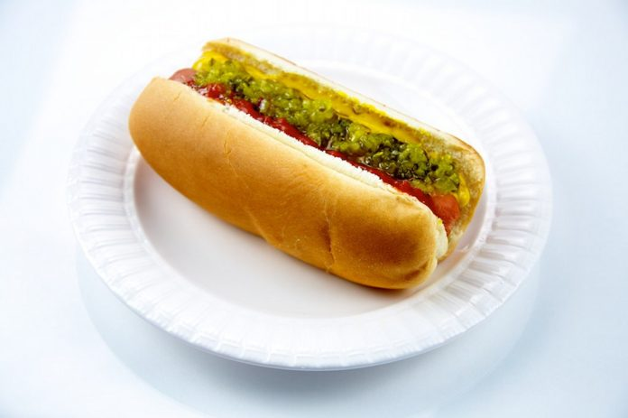 hot dog with relish ketchup mustard on plate