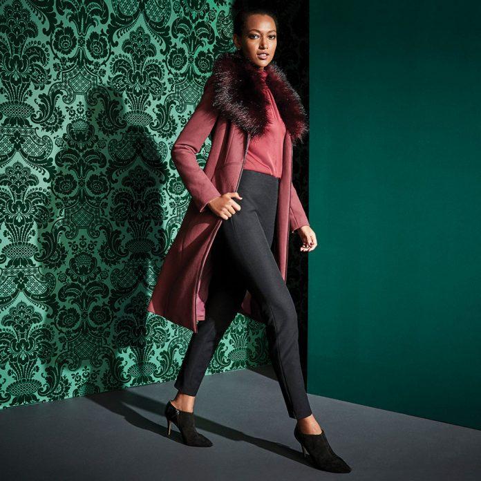 White House Black Market female model in jacket coat