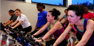 indoor cycling spinning class female riders