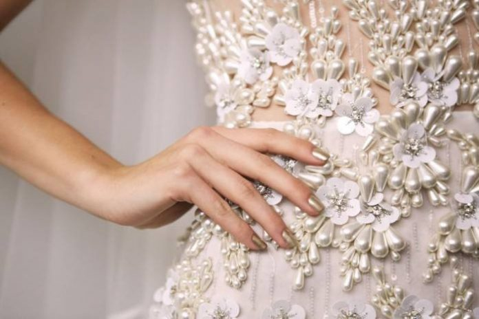 Grand Rapids Bridal Show wedding dress partial