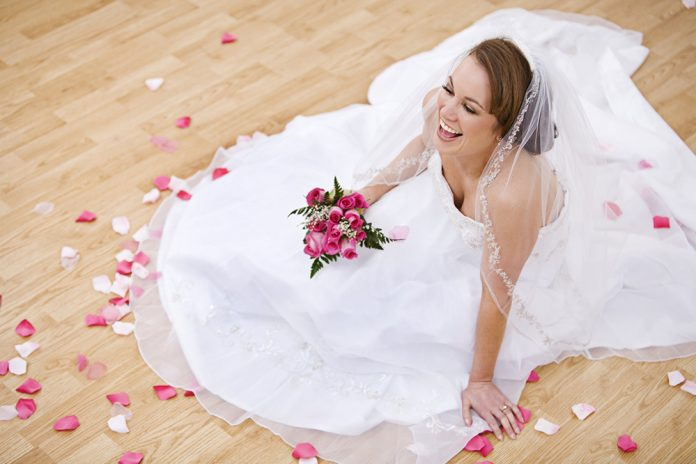 Winter Bridal Show of West Michigan bride in wedding dress holiding flowers