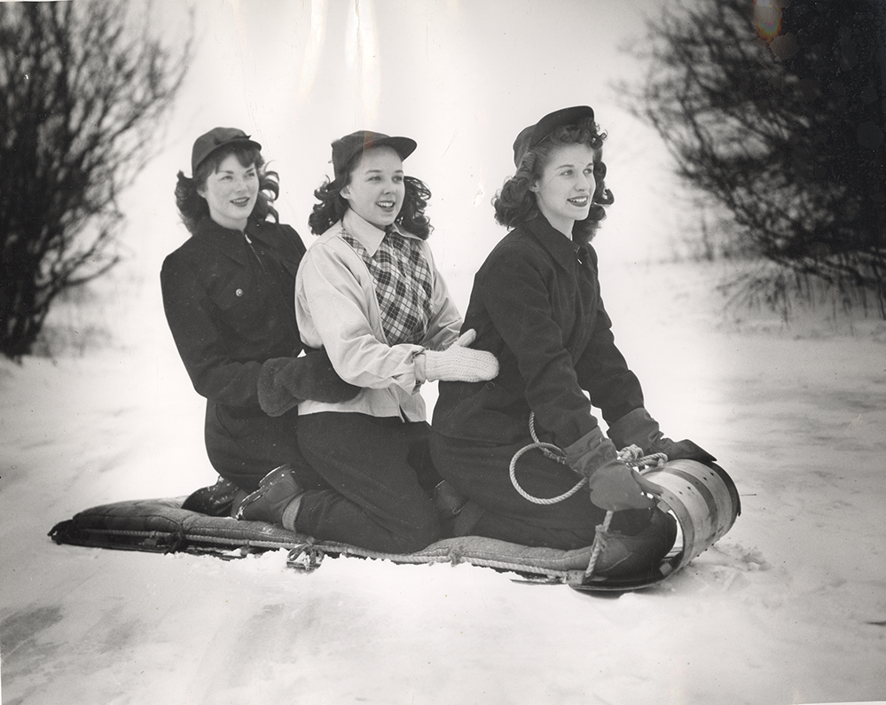antique photo of women sleding at Richmond Park in Grand Rapids